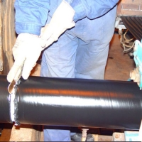 A Worker is Separating Two Pipes After Coating